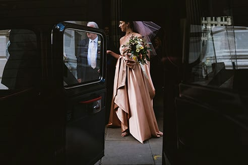 The Ned Wedding Photography London Gucci dress bride leaving for the ceremony