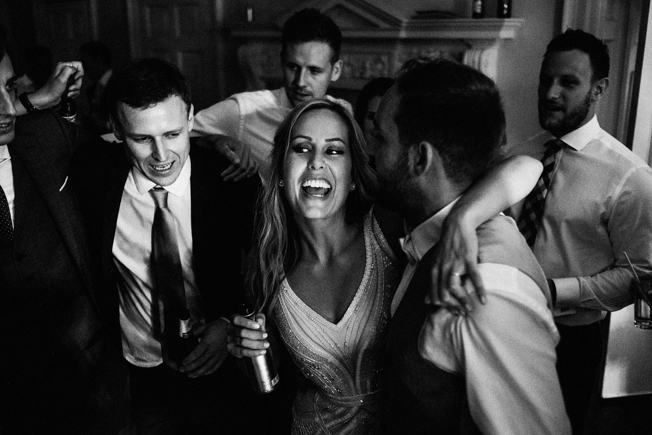 ancefloor at Morden Hall in black and white. Bride laughing.