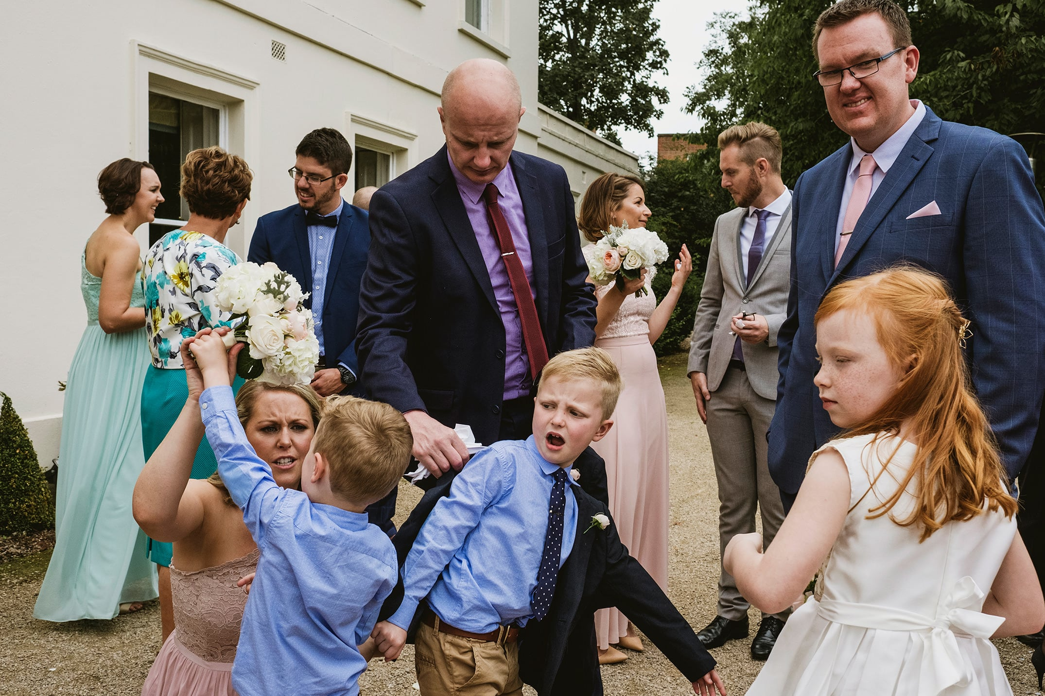 wedding reception chaos at Morden Hall in London. Children unimpressed.