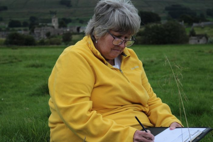 Dales Volunteer Jane Filby sketches the stack stand