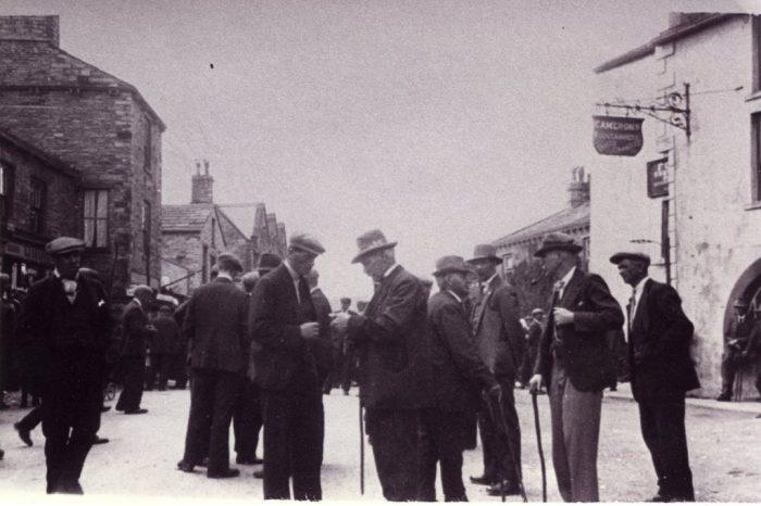 Hawes Market. Hiring Irishmen for haymaking late 1930's (pre war). Ann Holubecki collection