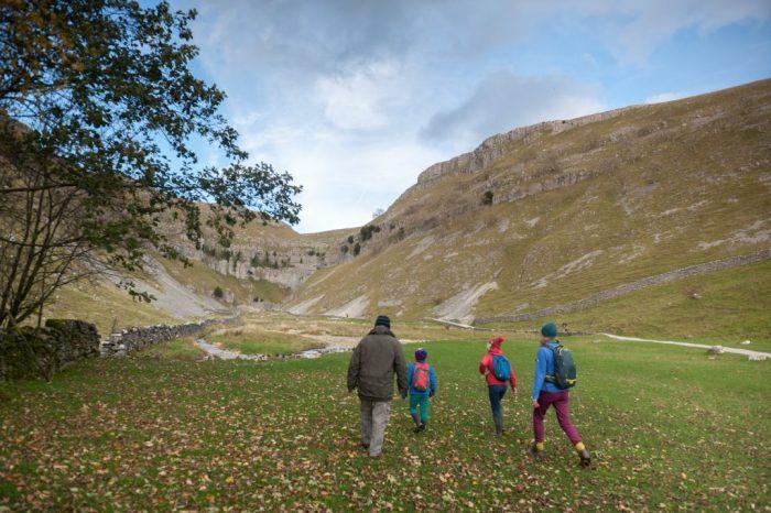 Family walking through Goredale Scar, Malhamdale, Yorkshire Dales National Park