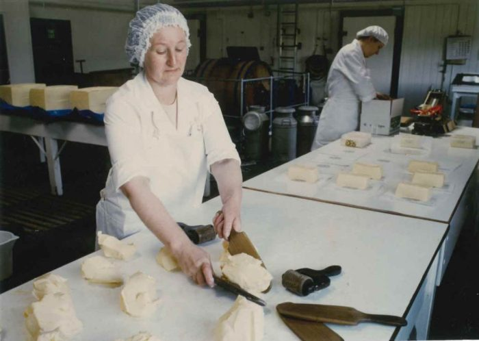 Shaping and packaging butter at the Creamery. 1980s. Courtesy of Ian Millward