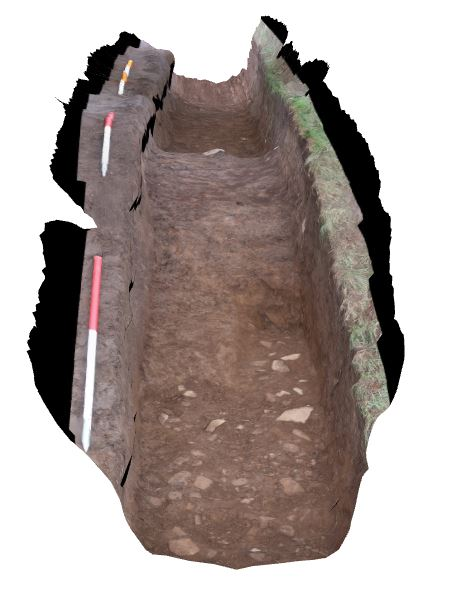 An image showing the bank of the larger stack stand part way through the dig, with the underlying cobbled surface visible in the foreground.