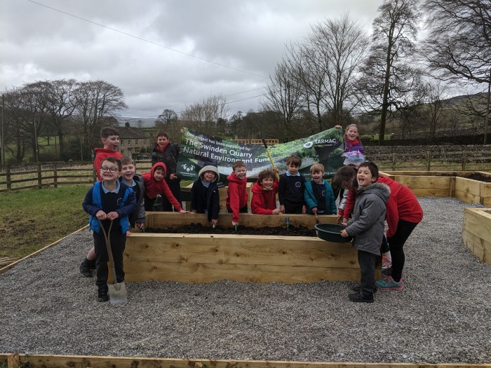 Some of the children at Cracoe and Rylstone Primary School in their new garden, part funded by the new Swinden Quarry Natural Environment Fund