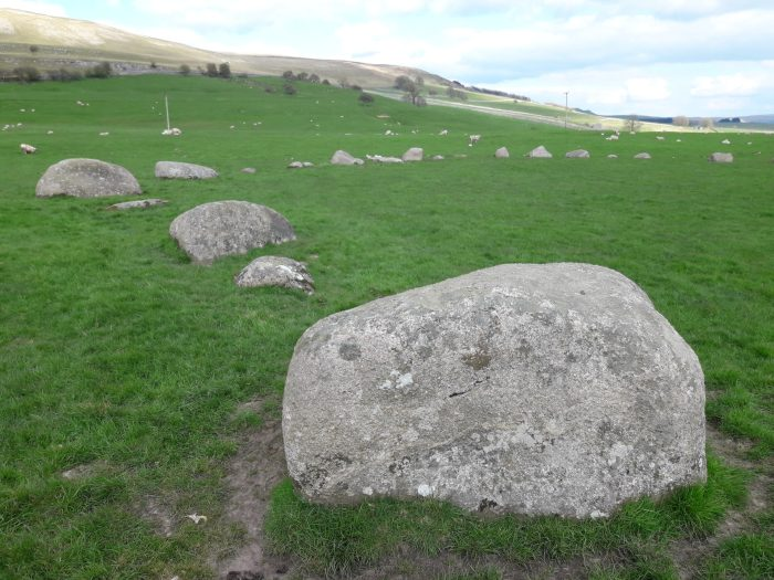 Image shows one section of the large stone circle, demonstrating the huge size of the boulders