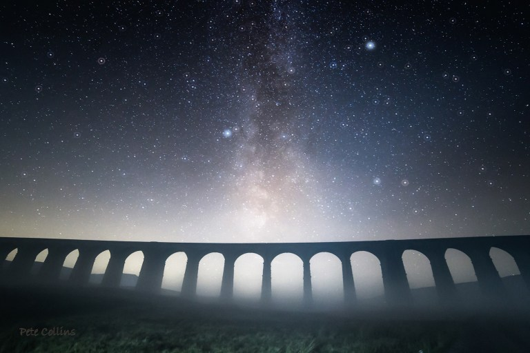 The Milky Way shining bright above Ribblehead Viaduct on a very misty, dark night