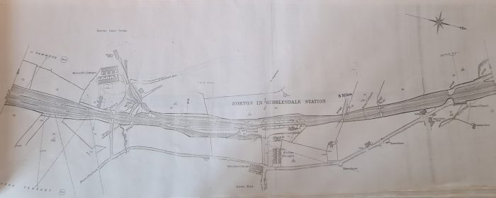 Image shows a carefully drawn map of the Settle-Carlisle Line (black and white) including details of the train station