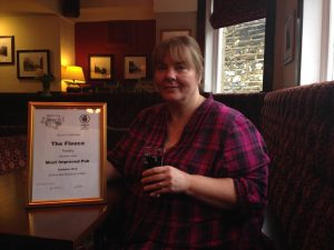 Gina Howard celebrates with her certificate.