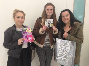 Georgia Lowbridge, 17, Emma Bentley, 16, and Courtney Croft, 16, arrive to meet 5SOS bearing gifts.