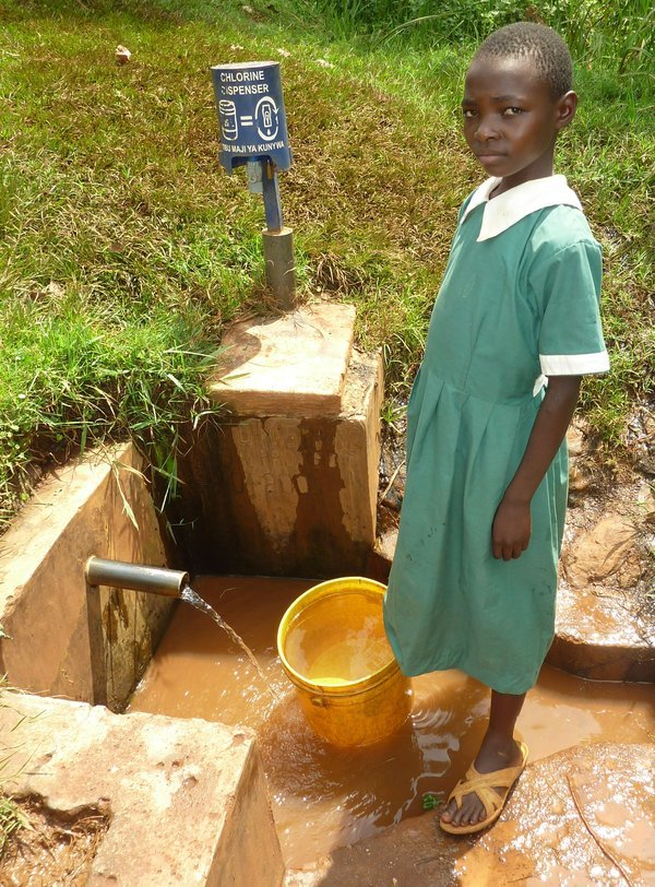 Image of a girl collecting water