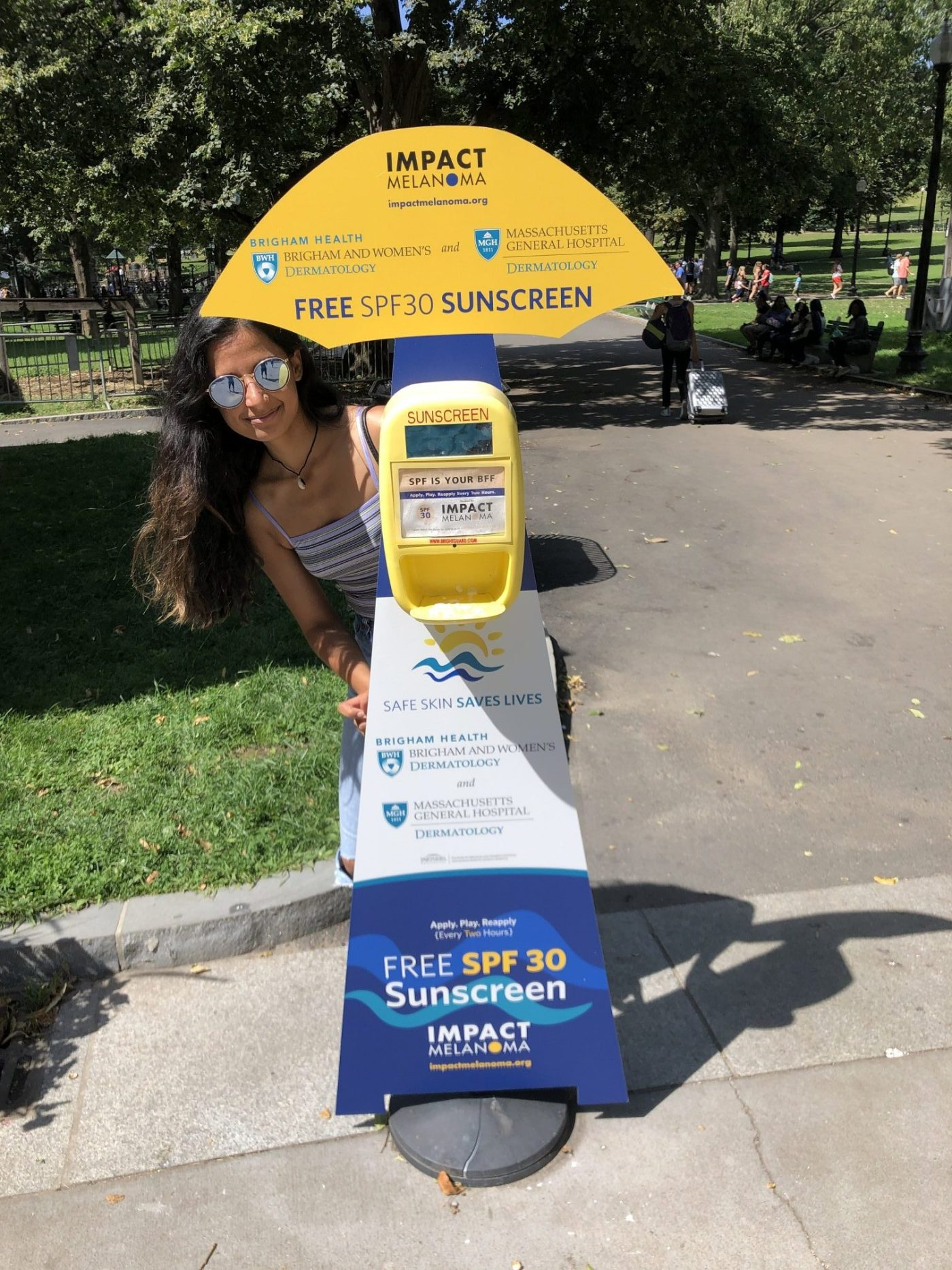 Friend poses with the sunscreen station