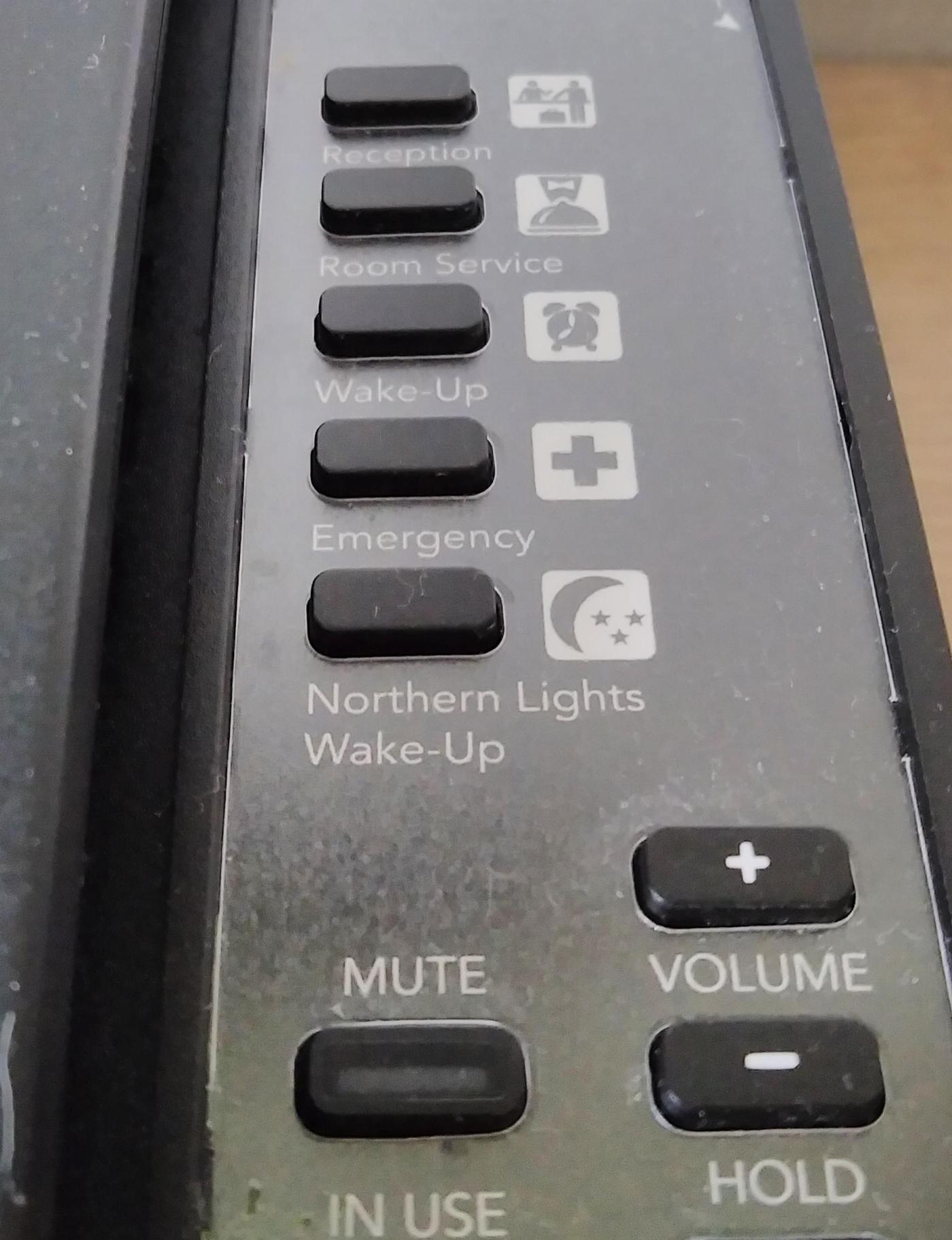 hotel phone with northern lights wake up button