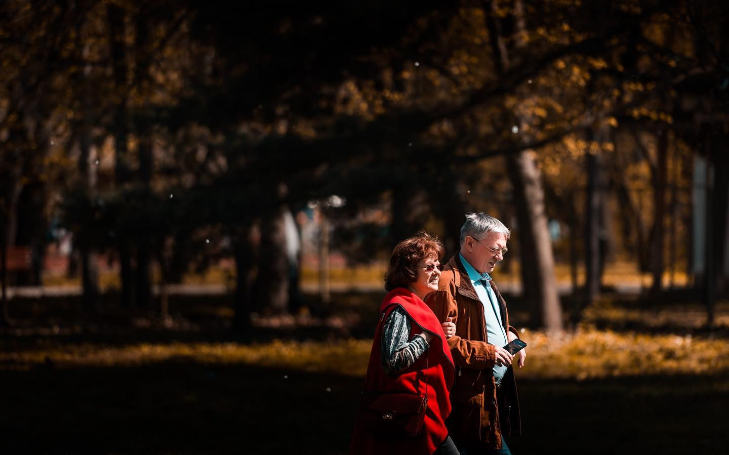 older couple walking outside in the autumn