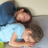 girls pretending to sleep on a couch