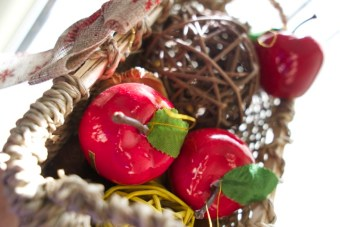 basket with vase fillers and red apple tree ornaments