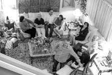 family gathered around a living room to open gifts
