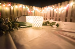 Rockin' Christmas 2015 rock theme party Dollar store decorations with candles and flowers outdoors