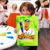 young artist with baseball player painting