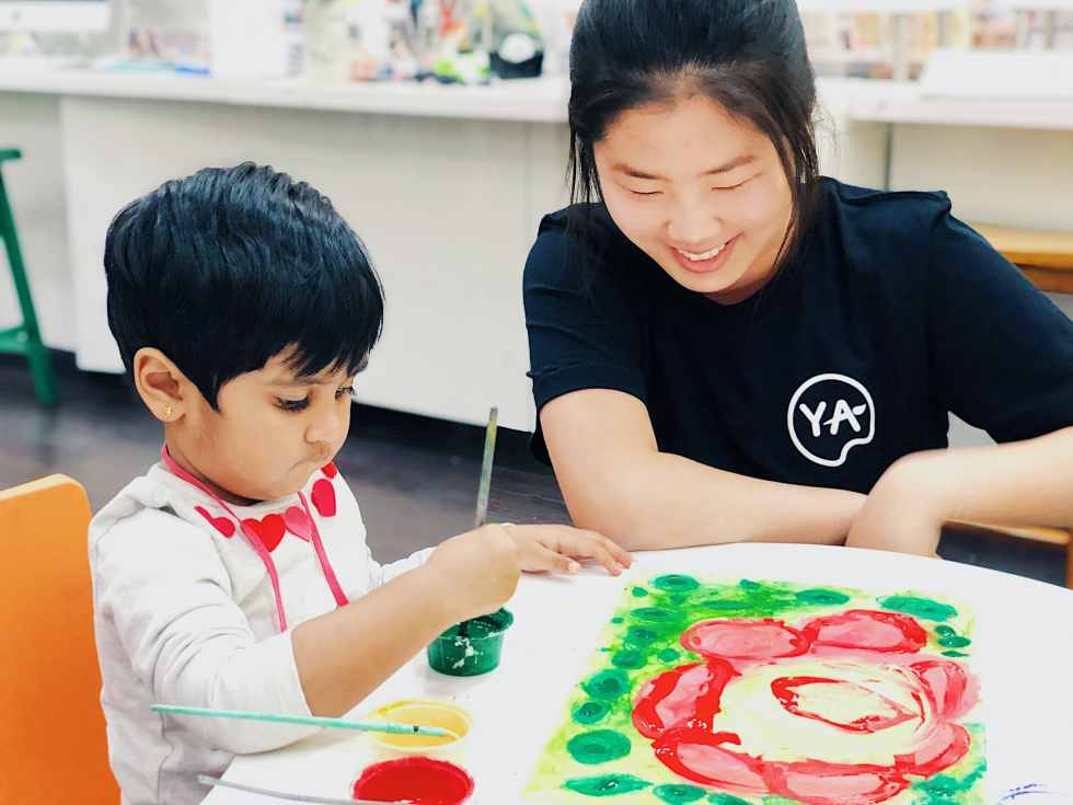 young art student with teacher making art