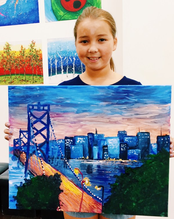 art student with painting with bay bridge artwork