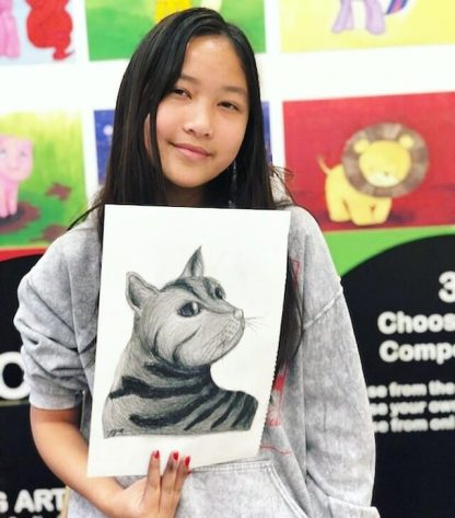 art student with sketch of cat