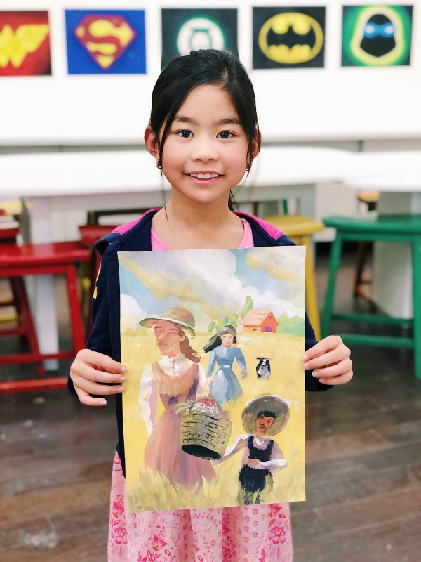 girl holding watercolored painting