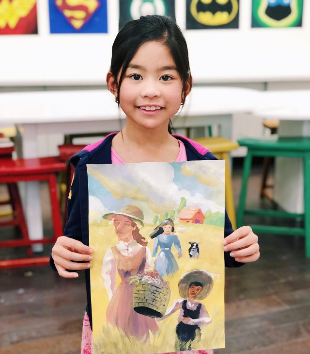 art student holding watercolor painted image