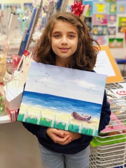 student showing art beach scenery