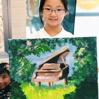 student with canvas artwork