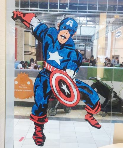 image of captain america leaping with shield drawn on glass