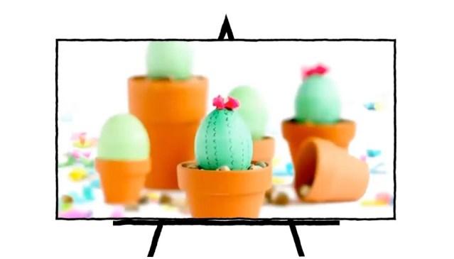 painted green easter egg with decorations to make it look like cacti in clay pot