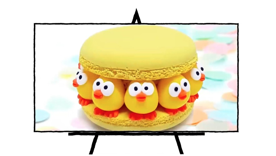 clay sculpture of yellow macaroon with chicks in between