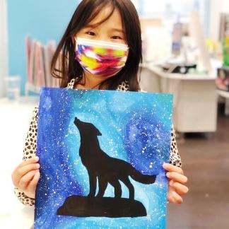 student holding painting of wolf