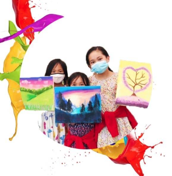 three girls showing finished artwork
