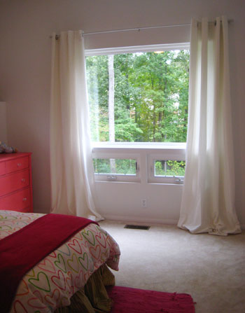 how to hang curtains high u0026 wide the window looks bigger