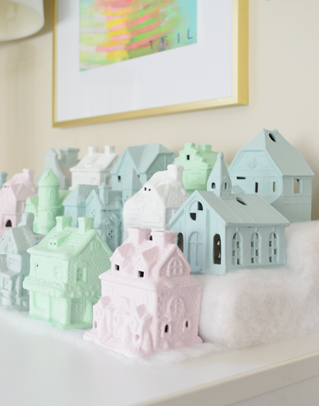 miniature Christmas village set in pastel colors
