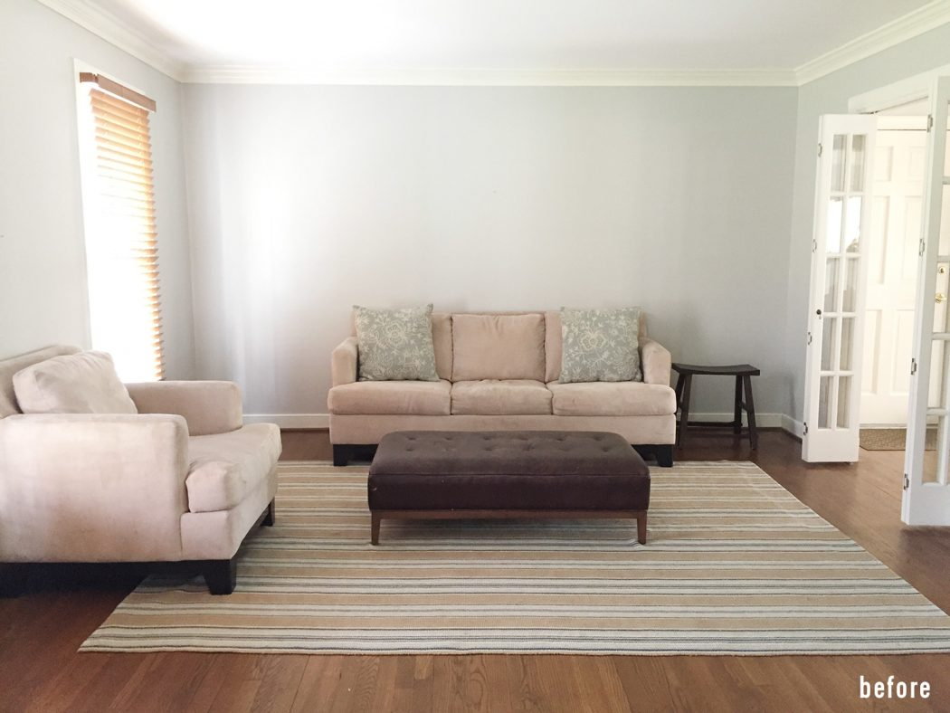 neutral living room before with nothing on walls