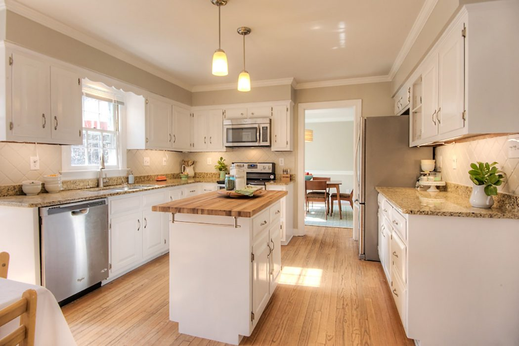 kitchen prepared to sell with painted cabinets and painted backsplash