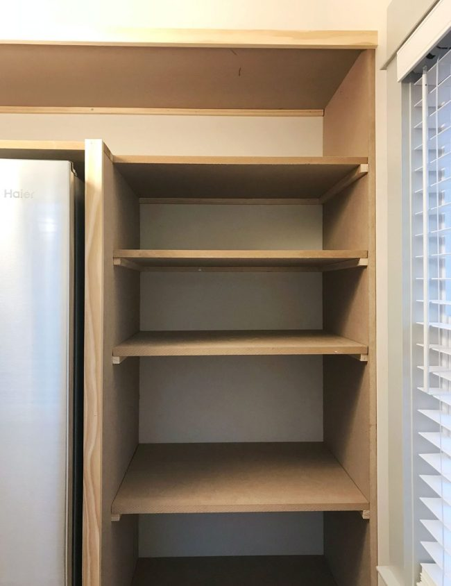 pantry shelves added on side of walk-in pantry