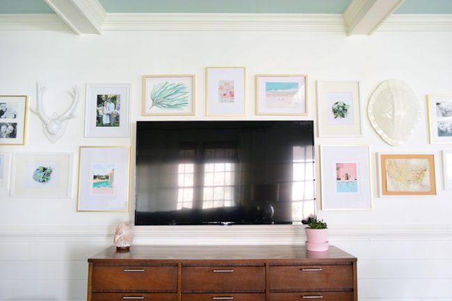 picture gallery wall around a tv on white walls