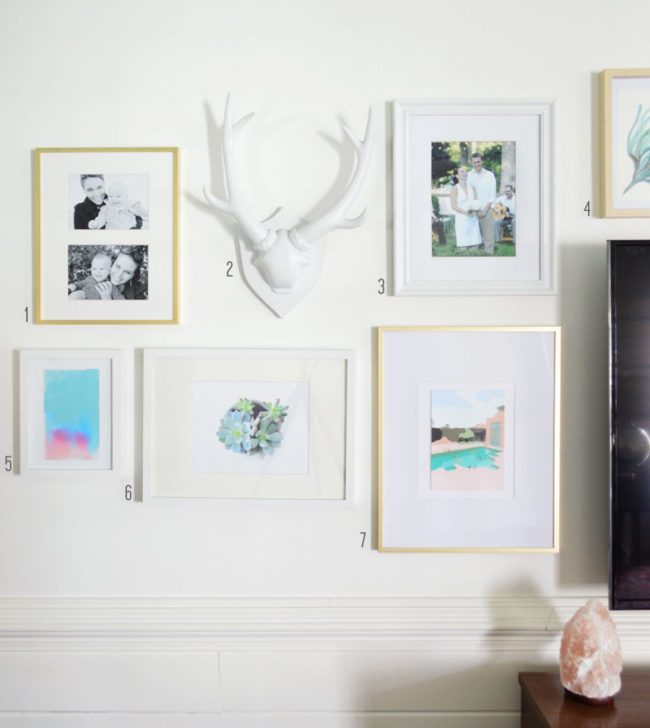 mix of photos art and objects to create eclectic gallery wall around a tv
