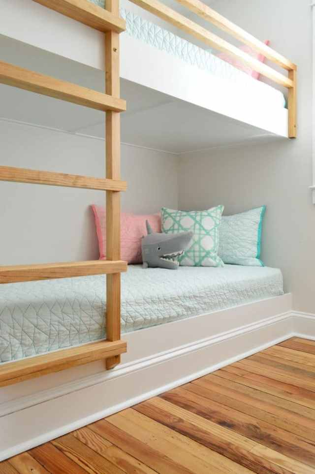 detail of bottom bunk of built in wall to wall bunk beds