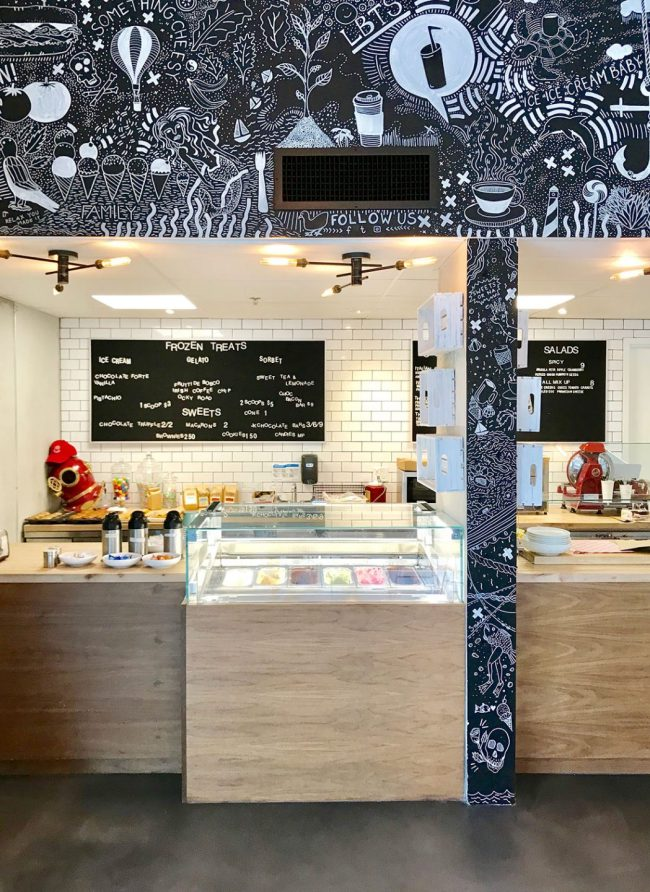 Inside of Bean and Barnacle Gelato with chalk drawings on wall