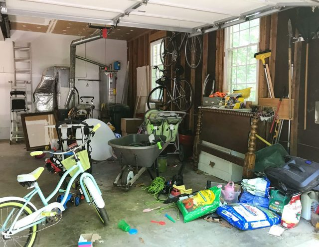 Messy garage with bike furniture and random outdoor supplies