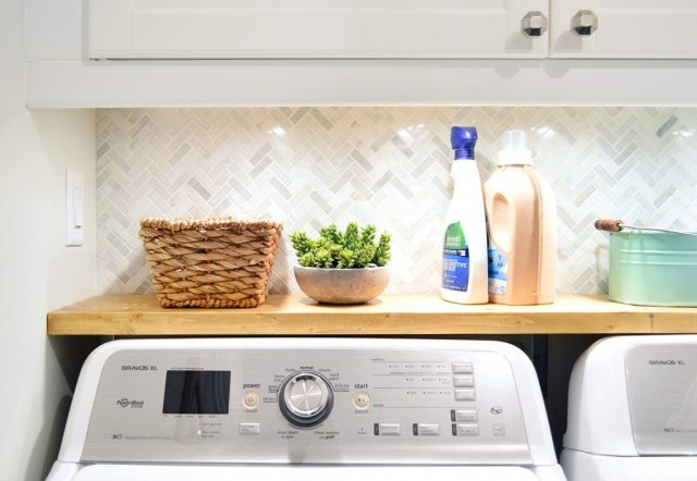 Laundry room shelf with faux succulent in cement pot