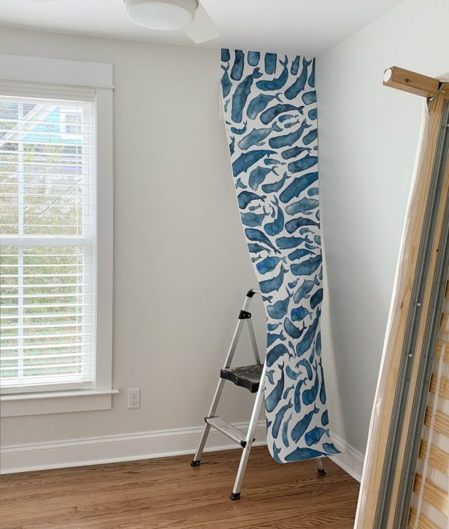 One Panel Of Whale Removable Wallpaper Partially Hung In Room