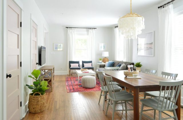 Open Living And Dining Room In Bright Beach House With Pink Doors