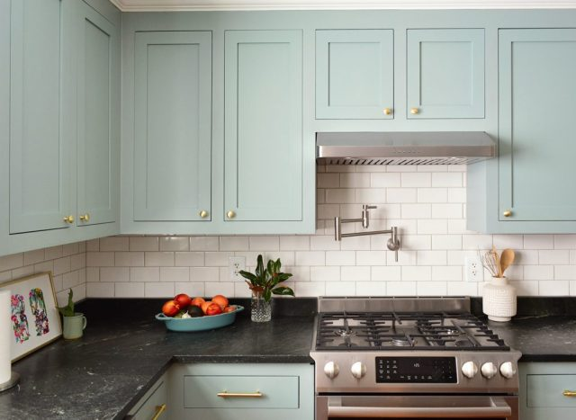 Halcyon Green Blue Kitchen Wall Cabinets With Gold Brass Knobs Above Stove