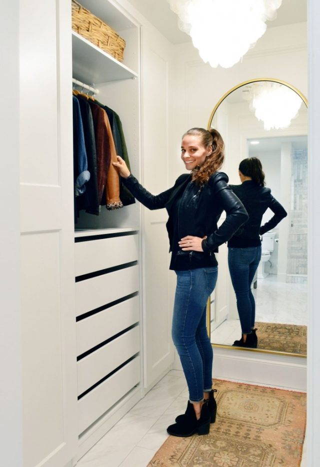 Sherry Standing In Remodeled Ikea Pax Master Closet With Gold Mirror